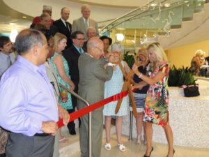 John Augelli at the First Floor Grand Reopening Ribbon Cutting Ceremony post Hurricane Ike, July 2013.