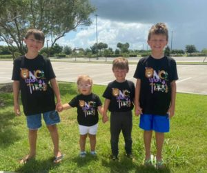 Picture of kids wearing their Summer Reading Club 2020 t-shirts