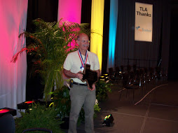 John Augelli holding the Texas Library Association's Librarian of the Year award, April 2010.
