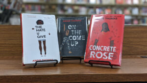 Three of Thomas's books displayed together. From left to right, 'The Hate U Give', 'On the Come Up', and 'Concrete Rose'.